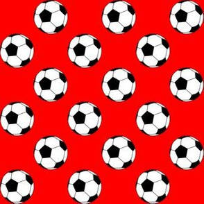 One Inch Black and White Soccer Balls on Red