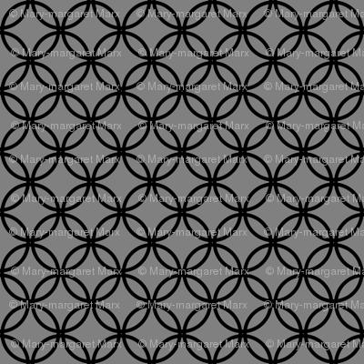 Black Overlapping Circles on Medium Gray