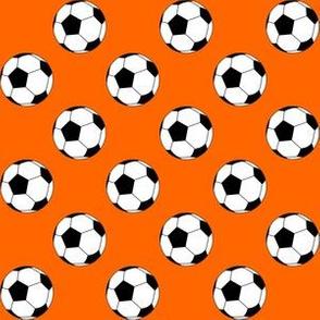 One Inch Black and White Soccer Balls on Orange