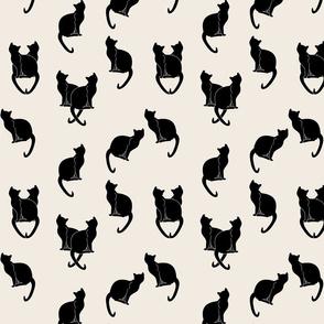 black cats on cream