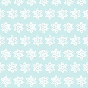 snowflakes in a pale blue sky