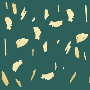 Gold paint blobs daubs on deep rich green