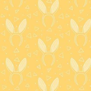 Bunny ears on yellow