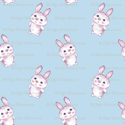 Cartoon rabbits on blue