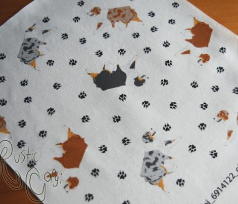 Tiny trotting Australian Shepherds and paw prints - white
