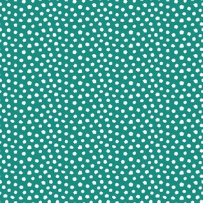 White spots on teal green