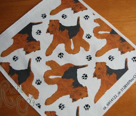 Trotting Welsh Terrier and paw prints - white