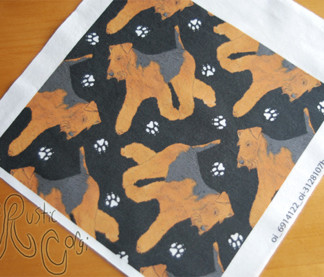 Trotting Welsh Terrier and paw prints - black