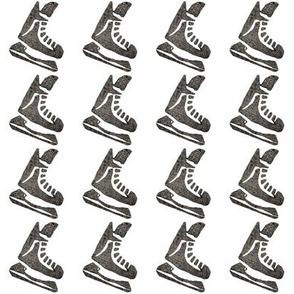 Skates on White