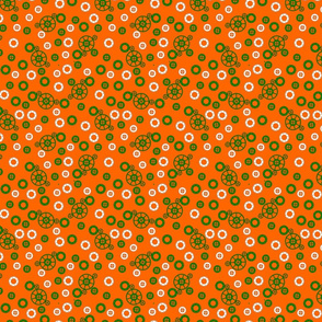Green and White Gears on Orange