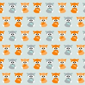 Baby foxes in orange and teal