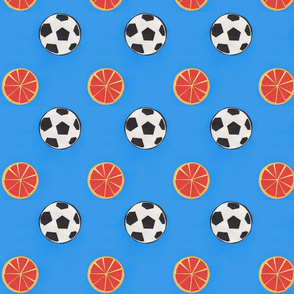soccer balls and oranges - azure blue background