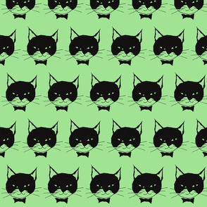 Black Cats on Green