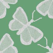 Textured White Butterflies on #69a076