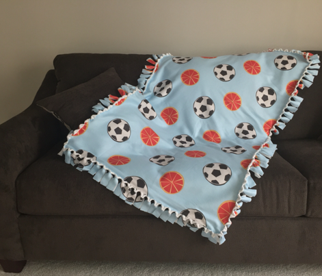 soccer balls and oranges | baby blue background