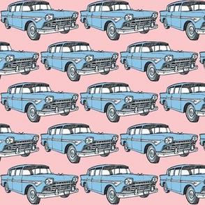 blue 1958  Rambler on pink background