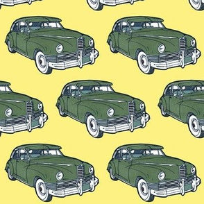 green 1946 Packard on yellow background