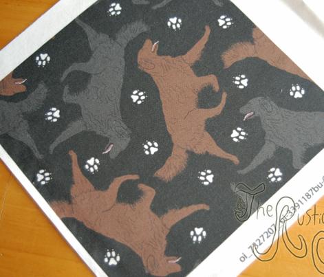 Trotting Flat coated Retrievers and paw prints - black