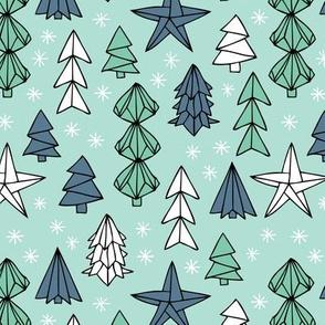 Christmas trees and origami decoration stars seasonal geometric december holiday design mint blue