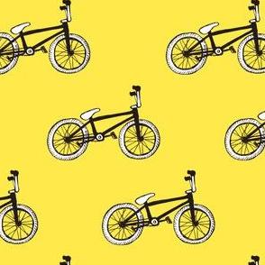 Little black&white bikes on sunny yellow