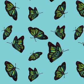 Butterflies on sky blue background