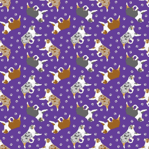 Small trotting Australian Shepherds and paw prints - dark purple
