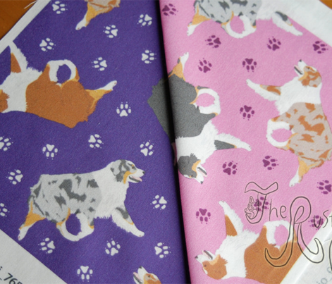 Small trotting Australian Shepherds and paw prints - pink