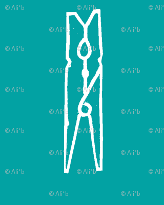 clothespins in a turquoise blue sky