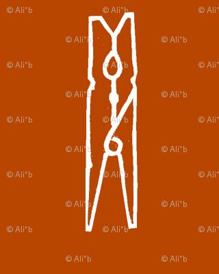 clothespin on rust orange