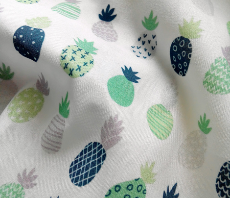 Pineapples in blue and greenery