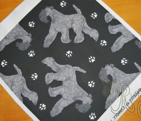 Trotting Kerry Blue Terrier and paw prints - black