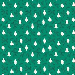 Christmas pine trees on green