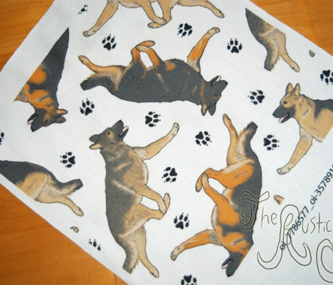 Trotting German Shepherd dogs and paw prints - white