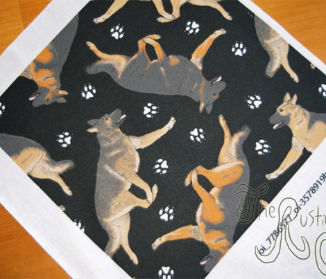 Trotting German Shepherd dogs and paw prints - black