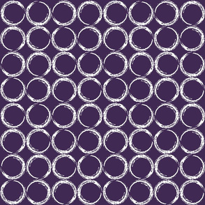 Circles in a geometric pattern on purple background