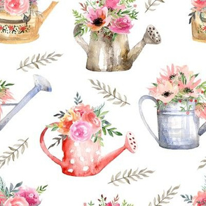Garden watering cans and flowers