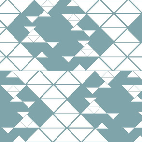 Triangles of different sizes in a x shape pattern with blue gray background