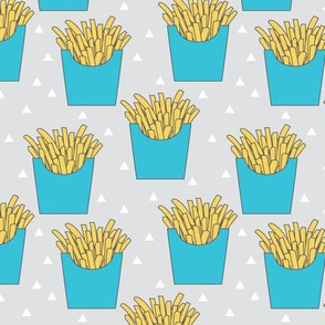 french-fries-with-blue-box-on-grey