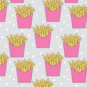 french-fries-with-pink-box-on-grey