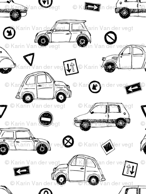 Black & white cars and traffic signs