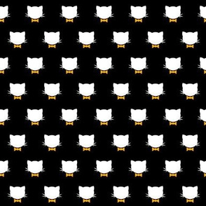 Tiny cats and golden bow ties