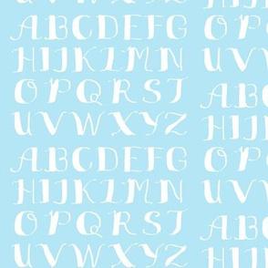 White Calligraphy Alphabet on Light Blue