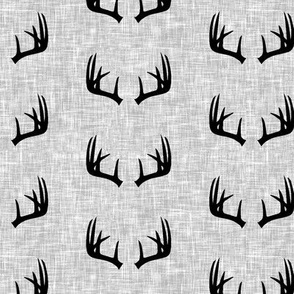 black antlers on light grey linen (small scale)