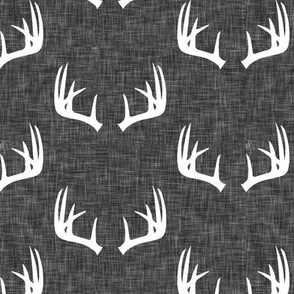 antlers on dark grey linen