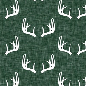 antlers on hunter green linen