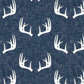 antlers on navy linen