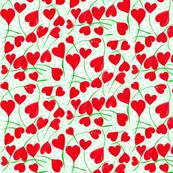 A Flutter of Heart Flowers on Green Dots