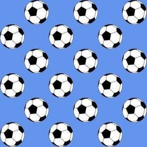 One Inch Black and White Soccer Balls on Cornflower Blue