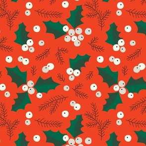 Christmas holly and berries on orange