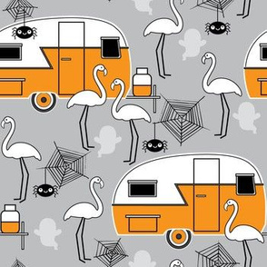 Halloween trailers and flamingos on grey